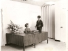 Reception desk in the Membership office - Rev. Edythe M. Clark standing, her secretary Mrs Jean Weinstein sitting
